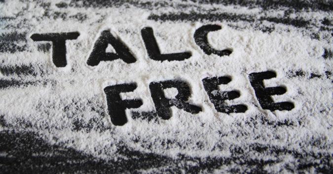 words talc free written in spilled talcum powder